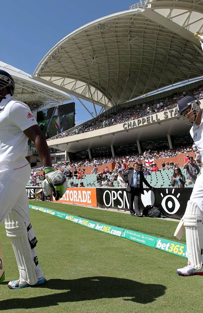 England's Michael Carberry, left, and Joe Root enter the ground for their second Ashes cricket test match against Australia in Adelaide, Australia, Saturday, Dec. 7, 2013