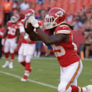In this Saturday, Aug. 23, 2014, photo, Kansas City Chiefs running back Jamaal Charles makes a catch before an NFL preseason football game against the Minnesota Vikings in Kansas City, Mo. Millions of people using the top three fantasy football platforms