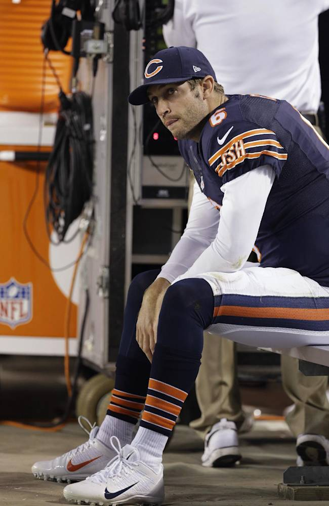 Chicago Bears quarterback Jay Cutler sits during the first half of an NFL football game against the New York Giants, Thursday, Oct. 10, 2013, in Chicago