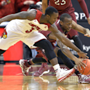 Louisville's Chris Jones, front, and Temple's Will Cummings reach for a loose ball during the first half of an NCAA college basketball game, Thursday, Feb. 27, 2014, in Louisville, Ky. (AP Photo/Timothy D. Easley)