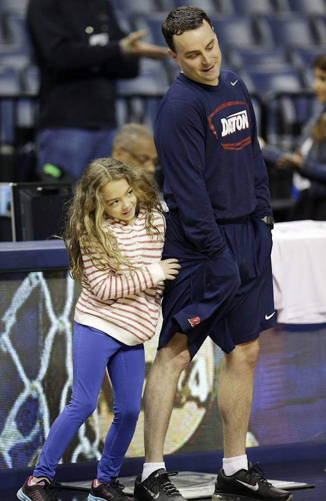 Dayton head coach Archie Miller watches practice with his daughter Leah Grace at the NCAA college basketball tournament, Wednesday, March 26, 2014, in Memphis, Tenn. Dayton plays Stanford in a regional semifinal on Thursday