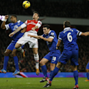 Arsenal's Olivier Giroud, second left, jumps to head the ball under pressure from Everton's Sylvain Distin, left and his teammate Gareth Barry, second right, during the English Premier League soccer match between Arsenal and Everton at the Emirates Stadi