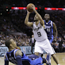 San Antonio Spurs' Tony Parker (9), of France, knocks over Dallas Mavericks' Monta Ellis, left, as he tries to score and Mavericks' DeJuan Blair (45) looks on during the first half of Game 2 of the opening-round NBA basketball playoff series on Wednesday,