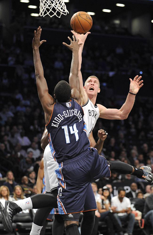 Brooklyn Nets' Mason Plumlee shoots over Charlotte Bobcats' Michael Kidd-Gilchrist (14) during the first quarter of an NBA basketball game Wednesday, March 19, 2014, at Barclay's Center in New York
