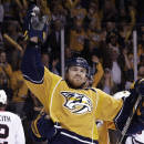 FILE - In this April 23, 2015, file photo, Nashville Predators center Colin Wilson celebrates after scoring a goal against the Chicago Blackhawks during the third period of Game 5 of an NHL hockey first-round playoff series in Nashville, Tenn. The Nashville Predators have signed forward Colin Wilson to a four-year contract worth $15.75 million. Under terms of the agreement announced Monday, July 27, 2015, Wilson receives $3.75 million in 2015-16 and $4 million each of the next three seasons. Wilson was a restricted free agent. (AP Photo/Mark Humphrey, File)