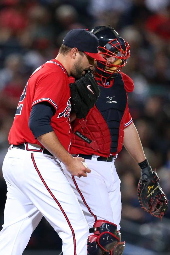 Atlanta Braves catcher Brian McCann, right, talks with reliever Jordan Walden after Walden gave up a solo home run to San Diego Padres' Chase Headley to tie the baseball game in the eighth inning Friday, Sept. 13, 2013, in Atlanta. The Padres won 4-3