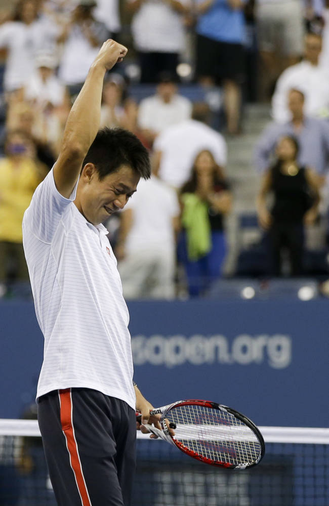 Kei Nishikori, of Japan, reacts after defeating Stan Wawrinka, of Switzerland, in five sets during the quarterfinals of the 2014 U.S. Open tennis tournament, Wednesday, Sept. 3, 2014, in New York. (AP Photo/Darron Cummings)