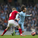 Manchester City's David Silva, right, fights for the ball against Middlesbrough's Adam Clayton during the English FA Cup fourth round soccer match between Manchester City and Middlesbrough at the Etihad Stadium, Manchester, England, Saturday, Jan. 24, 201