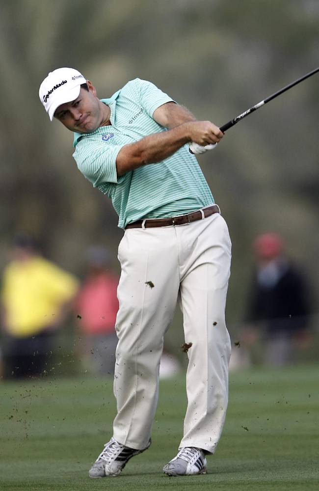 Richard Sterne of South Africa plays a ball on the 13th hole during the first round of the Dubai Desert Classic golf tournament in Dubai, United Arab Emirates, Thursday, Jan. 30, 2014