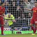 Liverpool s Joe Allen, right, reacts after a missed opportunity as team-mate Luis Suarez stands by during their English Premier League soccer match at Goodison Park Stadium, Liverpool, England, Saturday Nov. 23, 2013