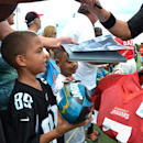 Marcus Johnson, 7, waits for an autograph from Chad Henne after practice Tuesday, Aug. 12, 2014, in Jacksonville, Fla. The NFL's Jacksonville Jaguars held last practice open to the public on Tuesday The Associated Press