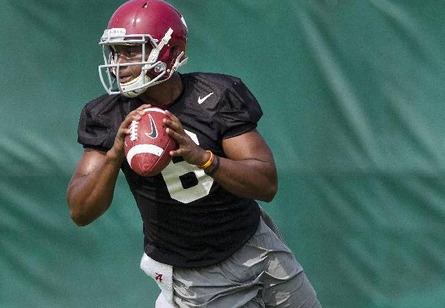 In this Aug. 1, 2014, file photo, Alabama quarterback Blake Sims (6) prepares to throw during an NCAA college football practice in Tuscaloosa, Ala. Florida State transfer Jake Coker and fifth-year senior Sims have been vying for the top job and coach Nick Saban says the two have been running neck-and-neck