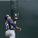 Milwaukee Brewers center fielder Carlos Gomez makes the catch hit by Oakland Athletics' Sam Fuld during the second inning of a spring training baseball game, Thursday, Feb. 27, 2014, in Scottsdale, Ariz The Associated Press