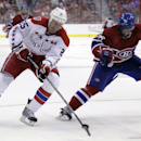 Washington Capitals' Jason Chimera (25) moves the puck against Montreal Canadiens' P.K. Subban (76) during the third period of an NHL hockey game, Thursday, Oct 9, 2014, in Washington. The Canadiens won 2-1 in a shootout. (Photo/Luis M. Alvarez) The Assoc