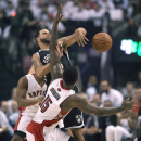 Toronto Raptors forward Amir Johnson (15) and Brooklyn Nets guard Deron Williams collide while chasing a loose ball during the first half of Game 2 in an NBA basketball first-round playoff series, Tuesday, April 22, 2014, in Toronto The Associated Press