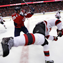 New Jersey Devils center Jacob Josefson, from Sweden, falls after being hit by Washington Capitals right wing Troy Brouwer (20) in the third period of an NHL hockey game, Friday, Nov. 14, 2014, in Washington. The Devils won 1-0 The Associated Press