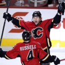 Calgary Flames' Dennis Wideman, top, celebrates his game-tying goal against the Colorado Avalanche with Kris Russell during the third period of an NHL hockey game, Thursday, Dec. 4, 2014 in Calgary, Alberta The Associated Press