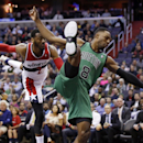 Washington Wizards guard John Wall (2) and Boston Celtics forward Jeff Green (8) land on the court after Wall's foul during Green's shot in the first half of an NBA basketball game Wednesday, April 2, 2014 in Washington. The Wizards won 118-92, and clinch