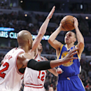 Golden State Warriors guard Stephen Curry, right, shoots over Chicago Bulls forward Taj Gibson (22) and Kirk Hinrich (12) during the first half of an NBA basketball game, Wednesday, Feb. 26, 2014, in Chicago The Associated Press