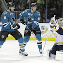 Nashville Predators goalie Pekka Rinne, right, makes a save as San Jose Sharks' Joe Pavelski, left, and Tomas Hertl (48) look on during the third period of an NHL hockey game Saturday, Dec. 13, 2014, in San Jose, Calif The Associated Press