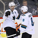 San Jose Sharks' Marc-Edouard Vlasic (44) celebrates with Joe Pavelski (8) after Vlasic scored against the Winnipeg Jets during the third period of an NHL hockey game Monday, Jan. 5, 2015, in Winnipeg, Manitoba The Associated Press