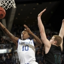Kentucky guard Archie Goodwin shoots as Notre Dame forward Scott Martin defends during the first half of an NCAA college basketball game Thursday, Nov. 29, 2012, in South Bend, Ind. (AP Photo/Joe Raymond)