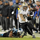 New Orleans Saints' Kenny Stills (84) runs past Carolina Panthers' James Dockery (31) after a catch in the second half of an NFL football game in Charlotte, N.C., Thursday, Oct. 30, 2014 The Associated Press