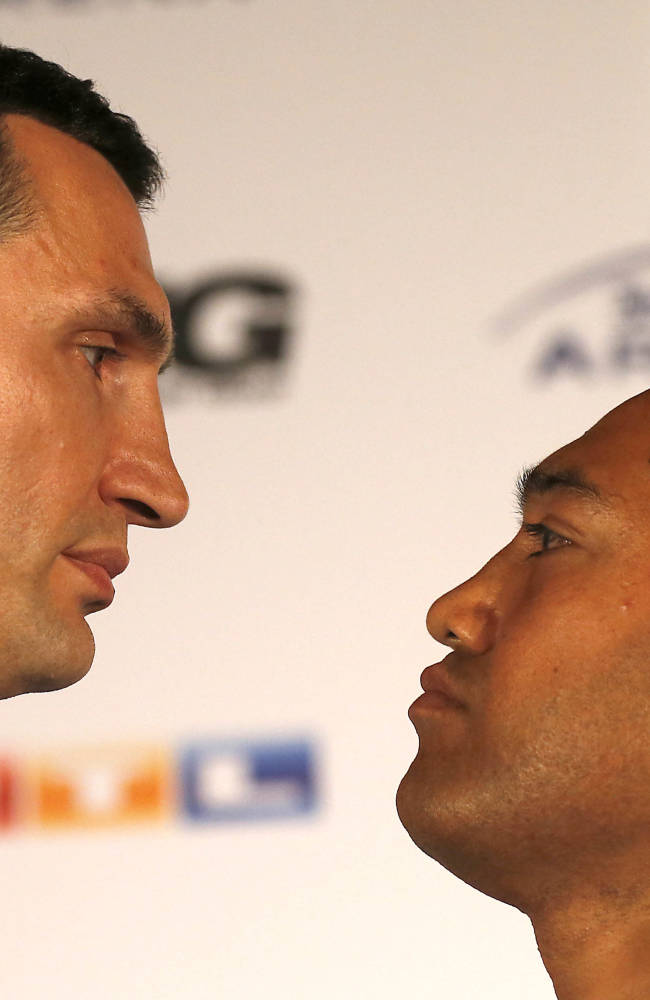 Wladimir Klitschko, left, and Alex Leapai stare down after a press conference ahead of the IBF, IBO, WBO and WBA heavyweight  title bout on April 26,2014 between Wladimir Klitschko of Ukraine and Alex Leapai of Australia in Oberhausen, Germany, Tuesday, Feb. 11, 2014