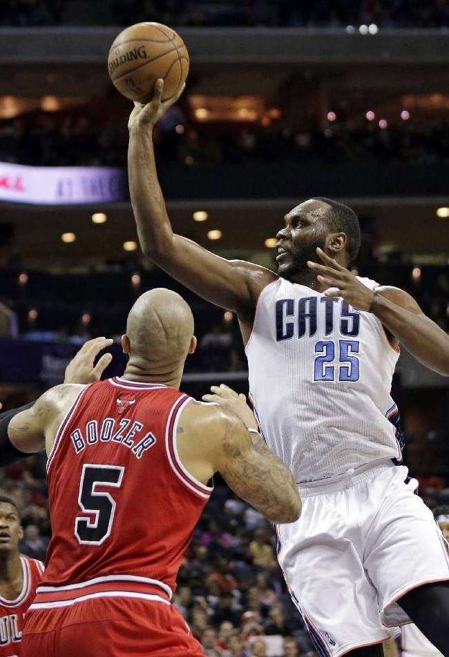 Charlotte Bobcats' Al Jefferson (25) shoots over Chicago Bulls' Carlos Boozer (5) during the first half of an NBA basketball game in Charlotte, N.C., Saturday, Jan. 25, 2014