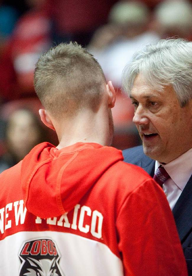 New Mexico head basketball coach Craig Neal, right, talks to his son and player Cullen Neal during his team's 109-93 victory over Charleston Southern in an NCAA college basketball game Sunday, Nov. 17, 2013, in Albuquerque, N.M