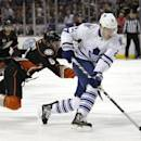 Toronto Maple Leafs' James van Riemsdyk, right, is defended by Anaheim Ducks' Ben Lovejoy during the first period of an NHL hockey game on Monday, March 10, 2014, in Anaheim, Calif. (AP Photo/Jae C. Hong)