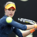 Eugenie Bouchard, of Canada, returns to Jelena Jankovic, of Serbia, at the Family Circle Cup tennis tournament in Charleston, S.C., Friday, April 5, 2013. Jankovic won 6-2, 6-1, to advance to the semifinals.  (AP Photo/Mic Smith)