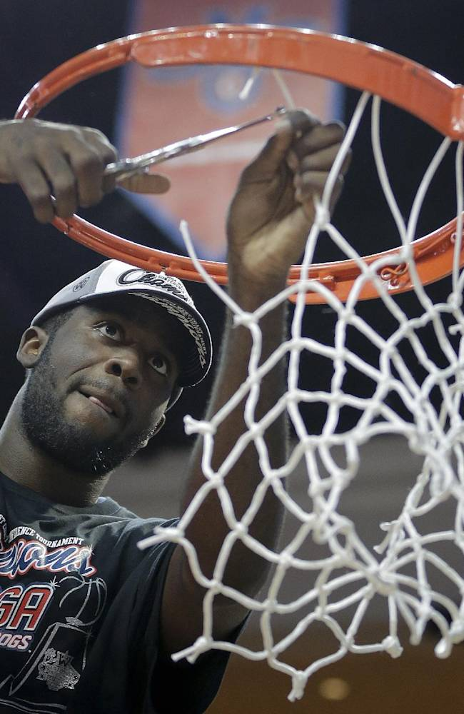 Gonzaga's Sam Dower Jr. cuts down the net after Gonzaga defeated BYU 75-64 in an NCAA college basketball game for the West Coast Conference men's tournament title, Tuesday, March 11, 2014, in Las Vegas