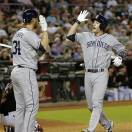 San Diego Padres' Chris Denorfia, right, high-fives teammate Andrew Cashner after both scored on a double by teammate Everth Cabrera during the fourth inning of a baseball game against the Arizona Diamondbacks, Saturday, May 25, 2013, in Phoenix. (AP Photo/Matt York)