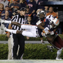 FILE - In this Oct. 25, 2014, file photo, Auburn's Jonathan Jones (3) intercepts a pass intended for South Carolina wide receiver Shaq Roland in the end zone during the second half of an NCAA college football game in Auburn, Ala. Mississippi's Senquez Golson and Auburn's Jones have emerged as the Southeastern Conference's top thieves. (AP Photo/Butch Dill, File)