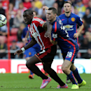 Sunderland's Jozy Altidore, left, vies for the ball with Manchester United's Micheal Keane, right, during their English Premier League soccer match at the Stadium of Light, Sunderland, England, Sunday, Aug. 24, 2014