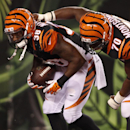 Cincinnati Bengals strong safety Danieal Manning (38) is congratulated by Sam Montgomery (70) after returning an interception for a touchdown in the first half of an NFL preseason football game against the Indianapolis Colts, Thursday, Aug. 28, 2014, in C
