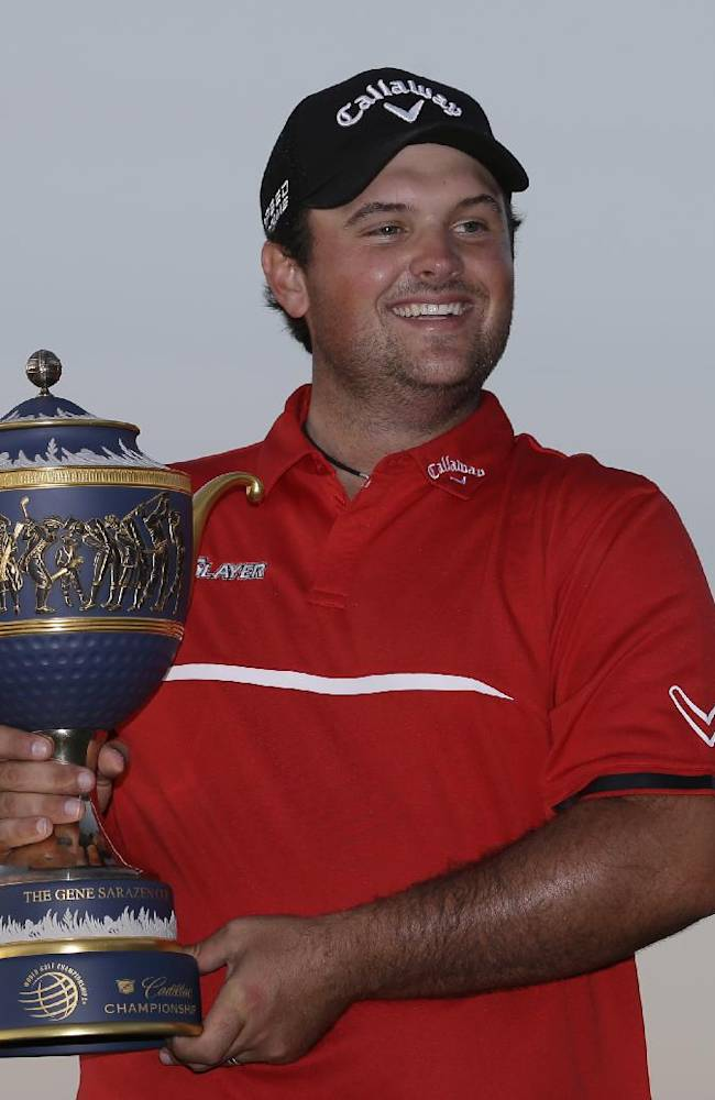Reed, dressed like Tiger, gets a big win at Doral