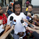 FILE - In this July 27, 2014, file photo, Washington Redskins quarterback Robert Griffin III speaks during a media availability after practice at the team's NFL football training facility in Richmond Va. The Redskins have allowed Griffin to break his silence about his injury, Friday, Oct. 24, 2014. Griffin referenced a Winton Churchill quote about courage, said he's been
