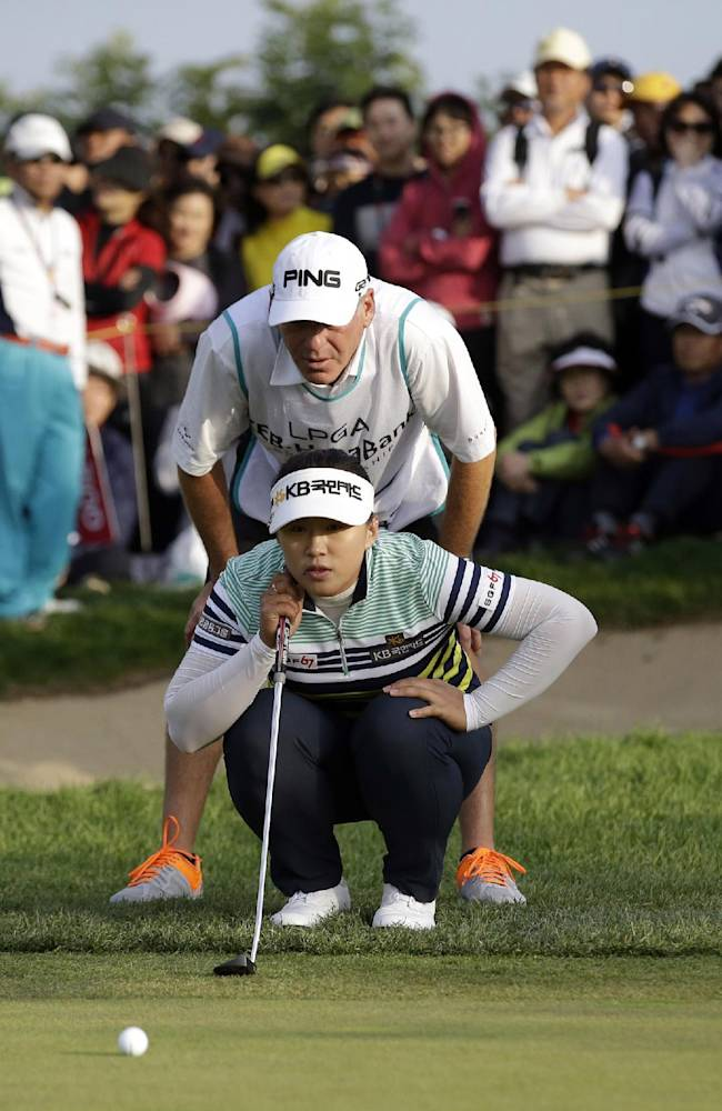 Amy Yang of South Korea lines up a putt in a playoff during the KEB Hana Bank Championship golf tournament at Sky72 Golf Club in Incheon, west of Seoul, South Korea, Sunday, Oct. 20, 2013