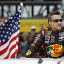 FILE - In this Feb. 23, 2014, file photo, Tony Stewart is introduced before the NASCAR Daytona 500 Sprint Cup series auto race at Daytona International Speedway in Daytona Beach, Fla. Stewart will return to Sprint Cup competition Sunday night at Atlanta Motor Speedway, ending a three-race hiatus taken after he struck and killed a fellow driver during a dirt-track race. (AP Photo/Terry Renna, File)