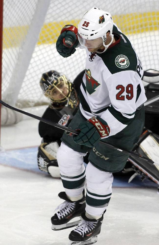 Minnesota Wild right wing Jason Pominville (29) pumps his fist after he scores against Anaheim Ducks goalie Jonas Hiller, left, of Switzerland defending in the third period of an NHL hockey game Wednesday, Dec. 11, 2013 in Anaheim, Calif. Ducks won 2-1