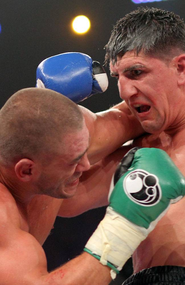 In  this picture taken Saturday Aug. 30, 2014 German boxer Marco  Huck right, and  Italian challenger Mirko Larghetti  exchange punches during their WBO cruiserweight title bout in Halle, western Germany.  German defending cruiserweight champion  Marco Huck defeated Mirko Larghetti of Italy by unanimous decision Saturday to retain his WBO belt for the record-equaling 13th time