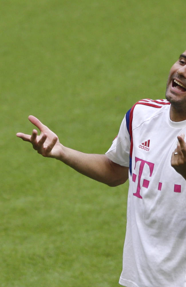 Bayern Munich head coach Pep Guardiola of Spain gestures during a training session after an official team presentation in the Allianz Arena stadium for the new German first division Bundesliga soccer season, in Munich, southern Germany, Saturday, Aug. 9, 2014. 65,000 spectators attended the event