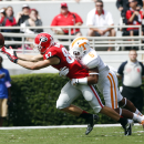 Georgia wide receiver Michael Bennett (82) can't reach a pass as Tennessee defensive back Todd Kelly Jr. (6) defends during the first half of an NCAA college football game, Saturday, Sept. 27, 2014, in Athens, Ga. (AP Photo/John Bazemore)