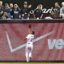San Diego Padres right fielder Will Venable makes a running catch on a deep drive by Los Angeles Dodgers' A.J. Ellis in the fifth inning of a baseball game Wednesday, April 2, 2014, in San Diego The Associated Press