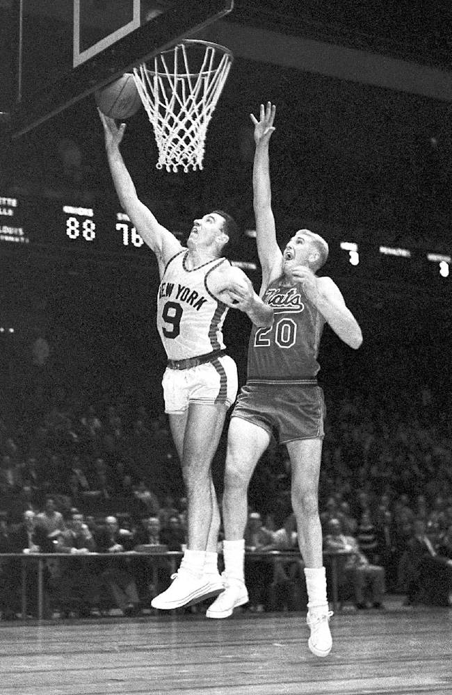This December 1959 file photo shows New York Knickerbockers' Richie Guerin (9) and Syracuse Nationals' Connie Dierking (20) during a basketball game at Madison Square Garden in New York.  Dierking has died at 77. His death was announced Monday, Dec. 30, 2013, by WKRC-TV, where his daughter Cammy Dierking is a news anchor. Dierking had been a 1958 first round pick of the Syracuse Nationals, and also played for the Philadelphia 76ers and San Francisco Warriors for more than a decade in the NBA