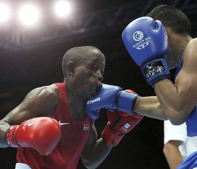 Scotland's Aqeel Ahmed, right, lands a punch on Kenya's Alumasa Matayo Keya in the Men's light flyweight preliminaries round bout at the Commonwealth Games Glasgow 2014, in Glasgow Scotland, Monday July 28, 2014