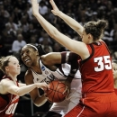 Texas A&M's Kelsey Bone, center, tries to get to the basket between Nebraska's Jordan Hooper (35) and Lindsey Moore (00) during a second-round game in the NCAA women's college basketball tournament in College Station, Texas, Monday, March 25, 2013. (AP Photo/Pat Sullivan)