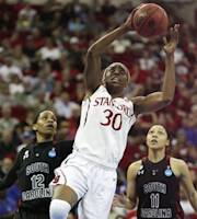 Stanford's Nnemkadi Ogwumike puts a shot up over a South Carolina's Charenee Stephens in the first half of an NCAA women's tournament regional semifinal college basketball game Saturday, March 24, in Fresno, Calif. (AP Photo/Gary Kazanjian)